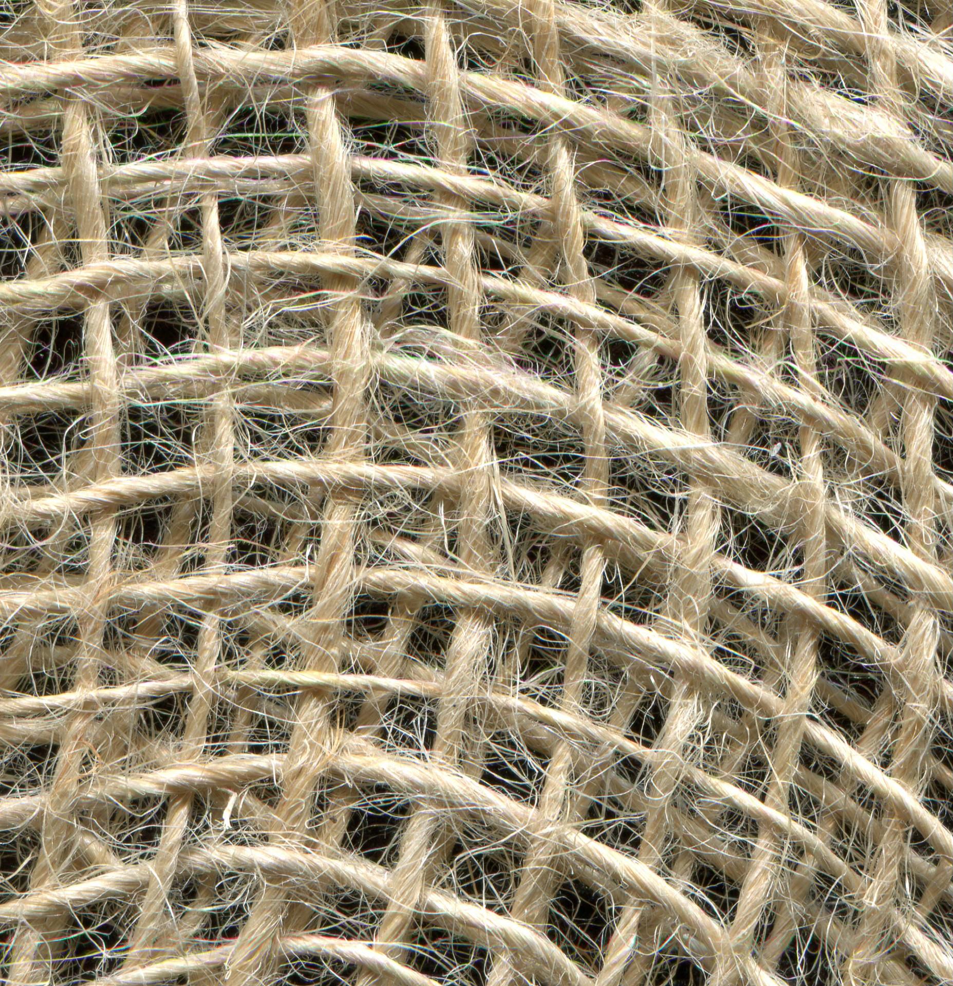 Detalhe de tecido com pelo eriçado. Como tiar mancha de caneta do sofá.