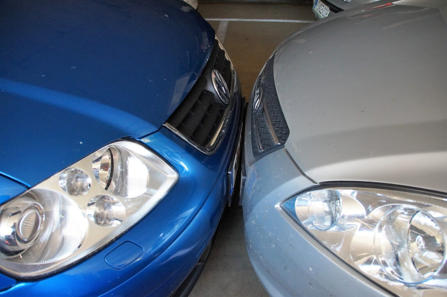 Blue metallic and silver cars, face to face.  Illustrative image aesthetic text of cars.